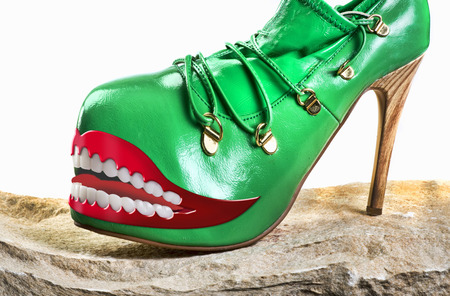 Green monster shoes with grinning teeth.