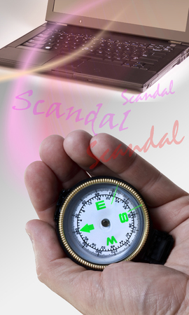 Computer scandal with compass in hand.