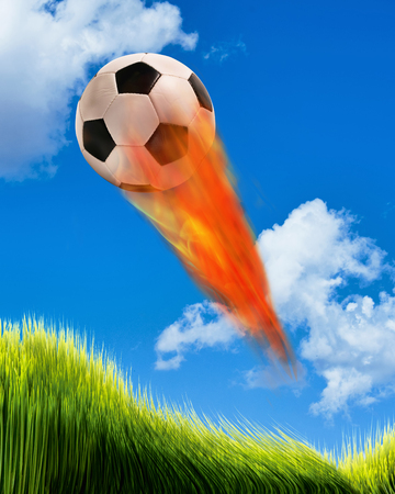 ball lightning: Soccer ball on fire and flying fast in the sky. Stock Photo