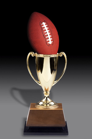 American football and golden trophy award. Stock Photo