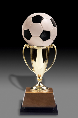Soccer ball and golden trophy award. Stock Photo