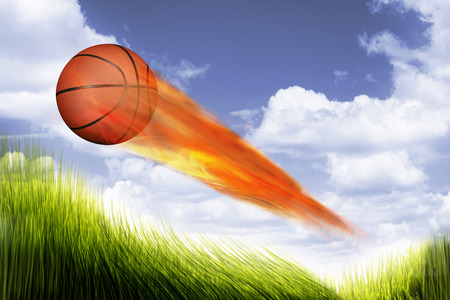 fierce competition: Basketball on fire burning up the sky.