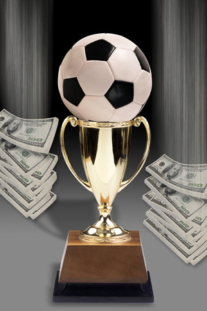 Soccer ball and American money.