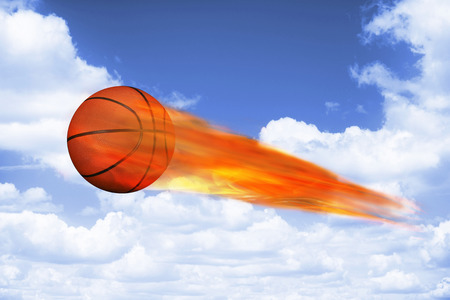 Basketball on fire flying fast. Stock Photo