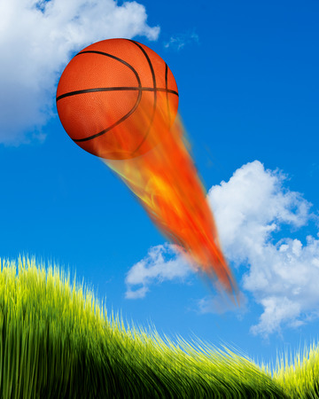 fierce competition: Basketball on fire flying fast. Stock Photo