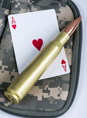 caliber: Ace of hearts and fifty caliber bullet.