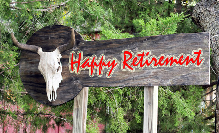 Happy retirement sign with cow skull.