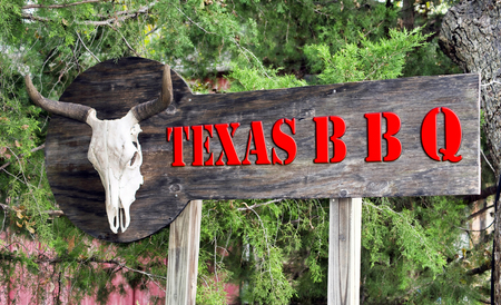 Texas BBQ sign with cow skull. Stock Photo