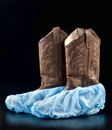Cowboy surgical boots with room for your type. Stock Photo