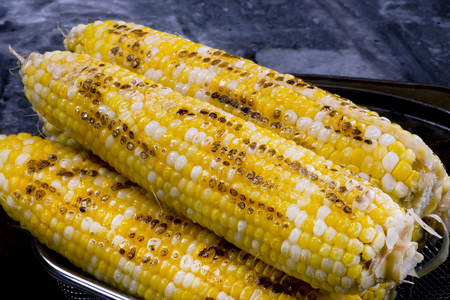 Yellow golden grilled corn on the cob. Stock Photo