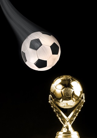 Soccer ball and golden soccer trophy with room for your type. Stock Photo