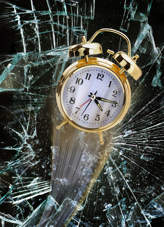 Time flying through broken glass window. Stock Photo