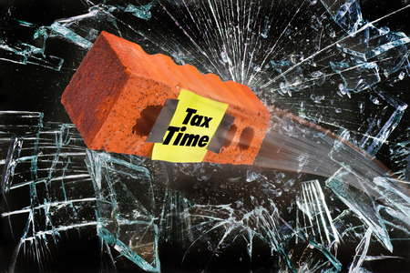 Its tax time with brick breaking glass window.