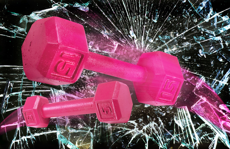 Pink power weights through the glass floor.