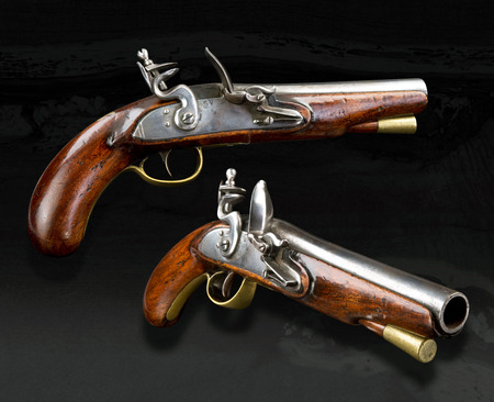 muzzleloader: Real English flintlock pistol made in the late 1700s.