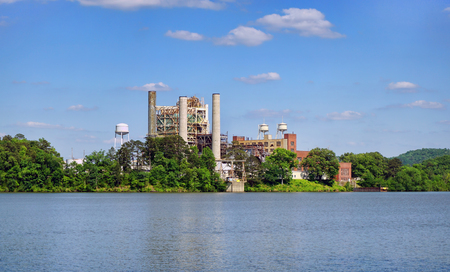 Electric steam plant at local lake that uses natural gas.. Stock Photo