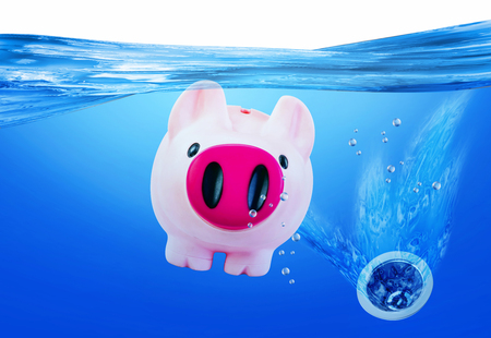 Pink piggy bank sinking into the drain.