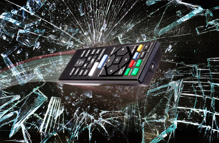 Remote control flying through broken glass. Stock Photo