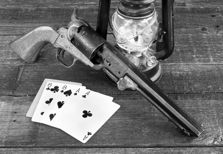 Dead mans hand , aces and eights in the old wild west in black and white. Stock Photo