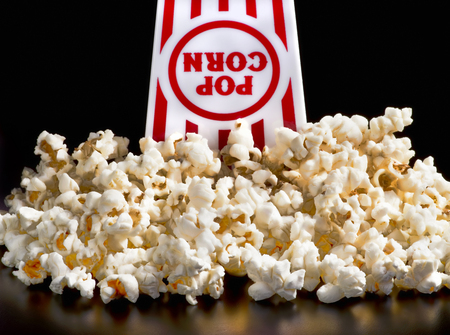 upside: Fresh golden popcorn ready to eat. Stock Photo