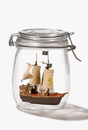 Pirate ship in a glass jar.