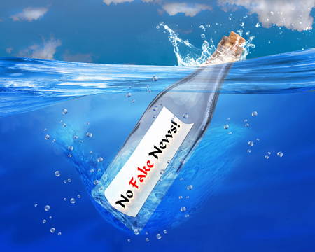 sinking: No fake news in a bottle. Stock Photo