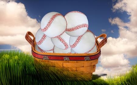 Basket full of baseballs in green field.