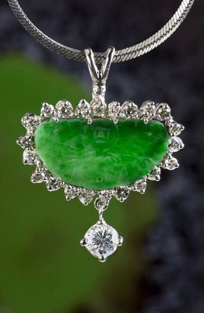 Antique green jade pendant and diamonds in white gold. Stock Photo