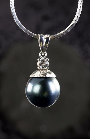 Big black Tahitian pearl with diamond in white gold..