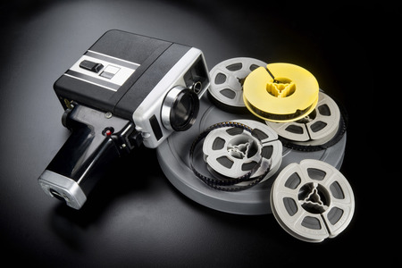 8mm movie camera and reels of film. Stock Photo