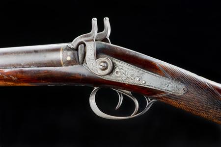 Antique double barrel shotgun closeup of firing hammers. Stock Photo