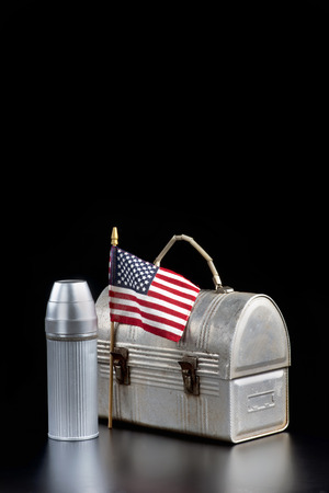 America  going back to work with lunchbox, drink with lots of room for your type.