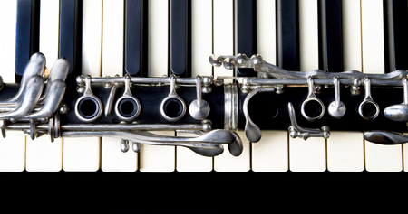 Closeup of a clarinet and keyboard.