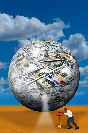 Money ball and worker with key. Stock Photo