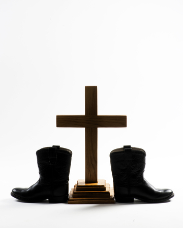 Cowboy Church with cowboy boots , Holy Cross and room for your type. Stock Photo - 84625640