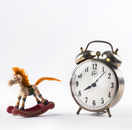 Rocking horse and alarm clock with room for your type. Stock Photo