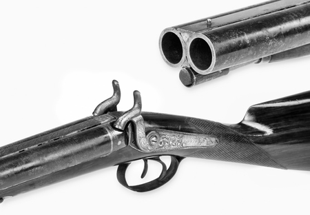 Antique double barrel shotgun in black and white with room for your type.