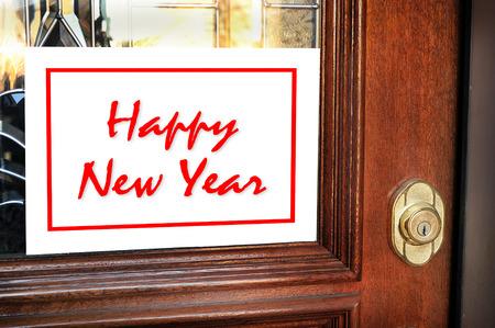 Happy New Year sign on home front door.