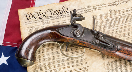 We the People with antique flintlock pistol and American flag. Stock Photo