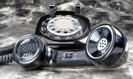 Old style black antique rotary telephone.