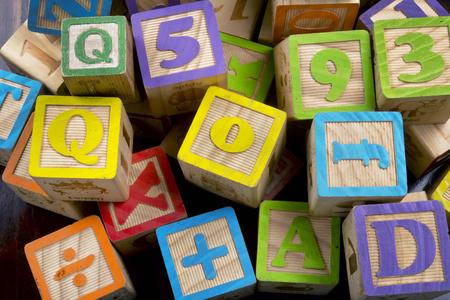 Wooden toy building letter blocks.