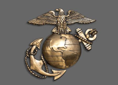 Emblema di aquila marina, globo e ancora in ottone. Archivio Fotografico