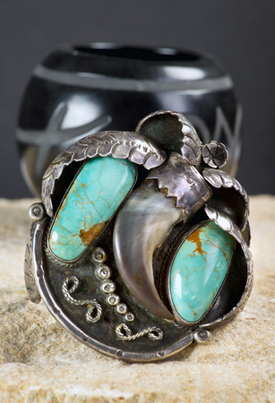 Antique Navajo silver and turquoise bear claw cuff.