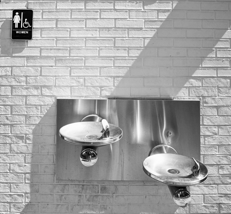 water fountain and women restroom in black and white. Stock Photo