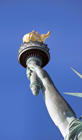 Statue of Liberty in NYC showing the arm and flame of life.