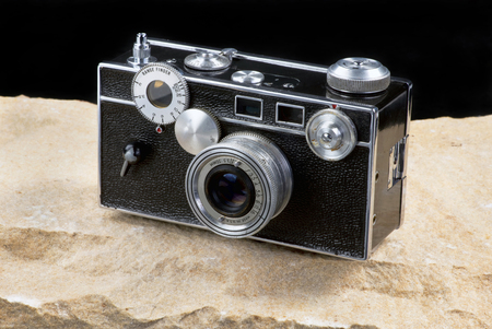 Old style film rangefinder camera sometime called the brick camera.