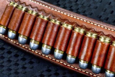 Cowboy gun belt full of bullets.