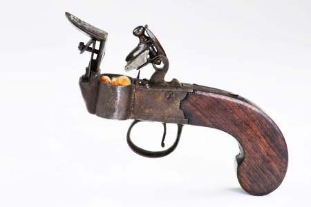 Antique English flintlock fire starter made around 1790-1800, before first  wood match stick which was made in 1826. Foto de archivo