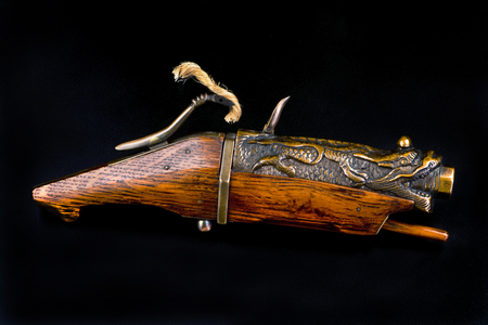 19th Century Chinese bronze dragon matchlock pistol, call a hand connon. Stock Photo