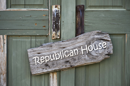 Republican house sign on old green doors.